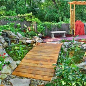 Bridge over Calm Koi Pond. Great design for entertaining and displaying beautiful garden fish. (Photo courtesy of thisoldhouse.com)